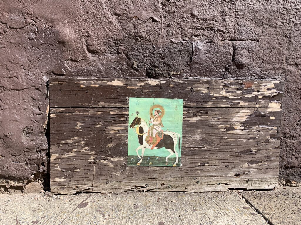 Image of Icon pasted on a row house.